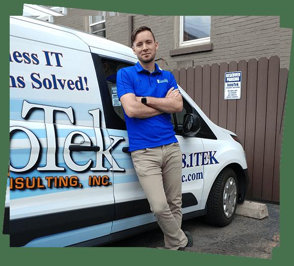 IT Worker in front of InnoTek Vehicle